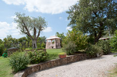 The Garden and the porch swing of the holiday home, Italy